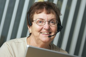 Smiling Senior Adult with Telephone