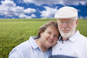 Loving Senior Couple Standing in Gra