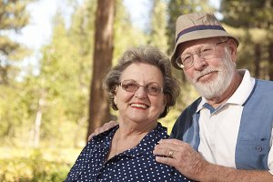 Loving Senior Couple Outdoors Portra