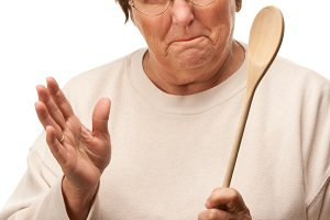 Upset Senior Woman with The Wooden S