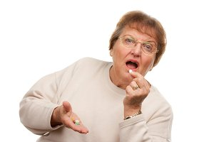 Attractive Senior Woman Taking Pills