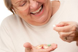 Attractive Senior Woman and Pills
