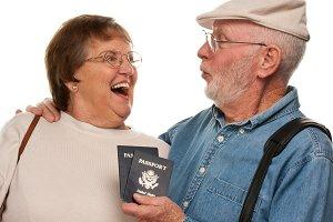 Happy Senior Couple with Passports a