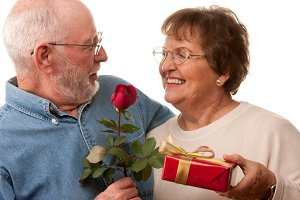 Happy Senior Couple with Gift and Re