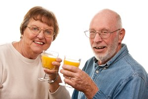 Happy Senior Couple with Glasses of