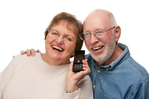 Happy Senior Couple Using Cell Phone
