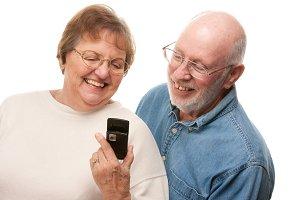 Happy Senior Couple Using Cell Phone