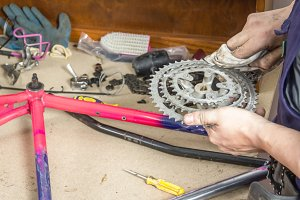 Mechanic cleaning chainring bike