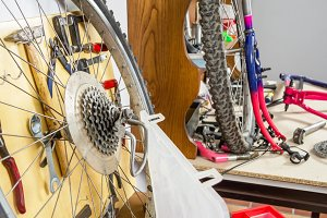 Wheel and bicycle parts in workshop