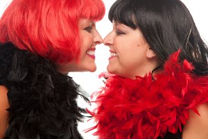 Red and Black Haired Women Smiling a