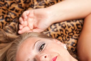 Beautiful Blonde Woman Poses on Leop