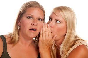 Two Blonde Woman Whispering Secrets