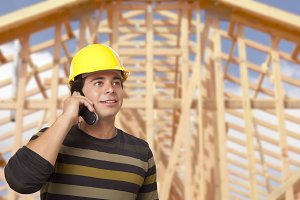 Hispanic Male Contractor on Phone in