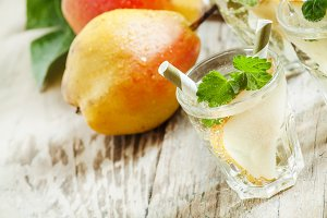 Pear cocktail with soda, fruit slice