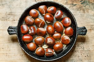 Roasted chestnuts in a pan, selectiv