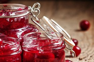 Delicious cranberry jam in glass jar