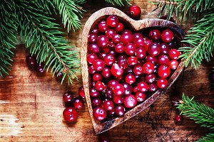 Fresh cranberries in bowl with heart