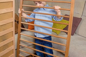 Kid assembling cot for a newborn