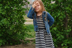 Little girl writhes her face