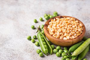 Fresh and dry peas on light