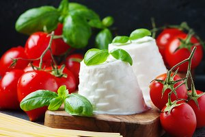 Fresh ricotta with tomato and basil