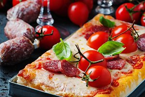 Pizza with salami and tomato