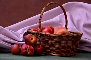 Basket with peaches and nectarines