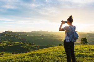 Woman taking photo in mountain