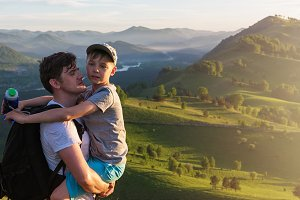 Happy father and son in the Altai