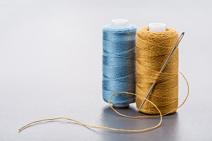 Two vertical coils of colored thread