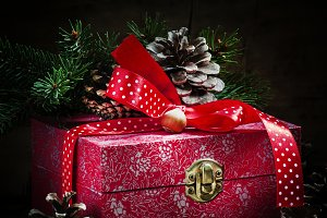 Holiday gift box decorated with red