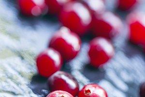 Wet cranberry  on a dark stone wet b