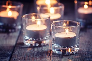 Burning small candles in glass candl