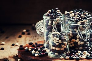multi-colored dry beans in glass jar