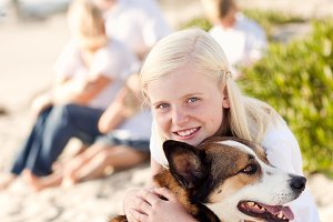 Cute Girl Playing with Her Dog Outsi