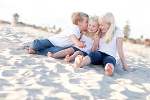 Adorable Sibling Children Kissing th