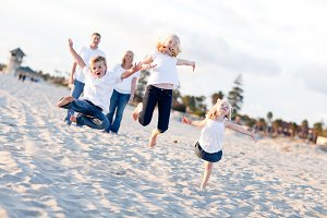 Happy Sibling Children Jumping for J