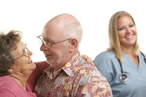 Senior Couple with Medical Doctor or