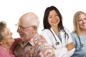 Senior Couple with Medical Doctors o