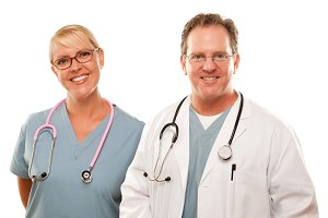 Smiling Male and Female Doctors or N