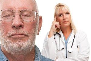 Concerned Senior Man and Female Doct