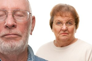 Concerned Senior Couple on White