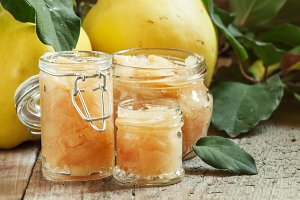 Pink quince jam in glass jars and fr