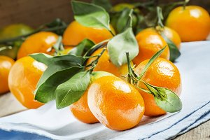Fresh ripe tangerines with green lea