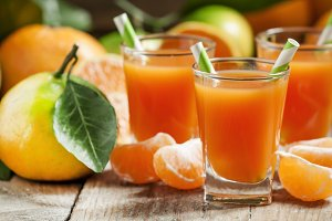 Fresh juice of ripe mandarins in a s