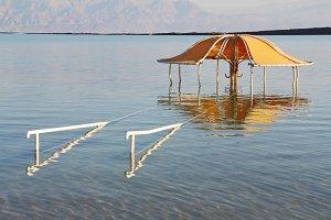 The beach pavilion is half flooded w
