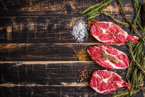 Raw juicy meat steak on wooden table