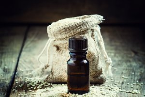Essential sesame oil in a bottle of