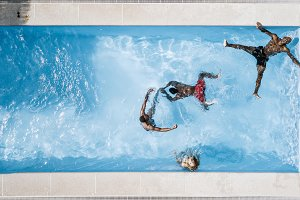 Young people have fun in the pool.