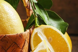 Slices of lemon and cut lemons with